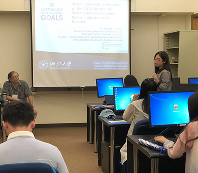 CIESIN director Robert Chen, left, listens to a student speak following his presentation at a summer seminar on environmental policy and sustainable development for students from Zhejiang University in Hangzhou, China.