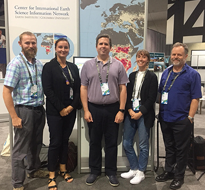 CIESIN staff in front of their exhibit booth at the 2018 Esri User Conference.