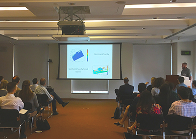 Kytt McManus presenting in front of an audience at the esri meetup May 30