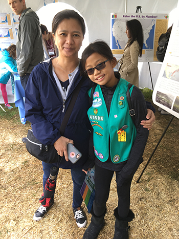 Lisa Lukang, CIESIN information specialist, with her daughter Isabelle, as they visit the CIESIN tent at the day-long Lamont Open House October 13.